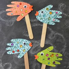 These beautiful Handprint Fish Puppets are super easy, really inexpensive and of course, fun for ALL ages!