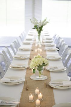 White linens. White flowers. White Candles. White Chairs.  Burlap Table Runner.  Our Farm Wedding. Check it out at Casual Elegance Blog.