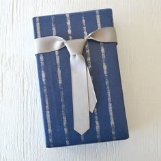 what a simple and clever idea for a bow on a present!  A tie!