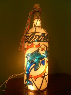 Miami Dolphin Lighted wine Bottle by HillysBoutique on Etsy https://www.etsy.com/listing/257424704/miami-dolphin-lighted-wine-bottle