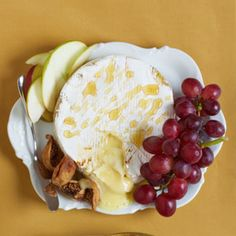 Baked Brie with Honey  A drizzle of honey adds a bit of sweetness to savory Brie. Pair this Baked Brie with Honey appetizer with grapes, dried figs, or apple slices