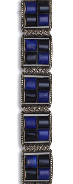 A lapis lazuli, onyx and marcasite bracelet, Theodor Fahrner, circa 1930 designed as five square panels of arched lapis lazuli and onyx with cylindrical marcasite spacers and borders; with maker's mark TF for Theodor Fahrner; mounted in silver; length: 7in. (several marcasite deficient)