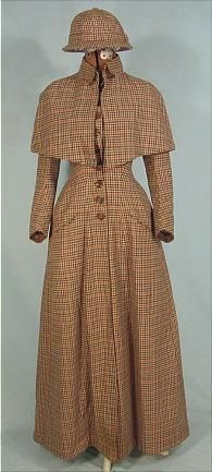 1870-1890 Costume for Women. 1888 plaid wool ulster coat with detachable cape.