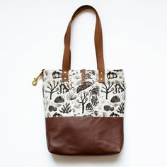 ***Made to order, can take up to 2 weeks.***  Large natural linen tote with brown leather straps and bottom  Screen printed with non-toxic black
