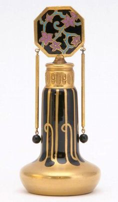 DEVILBISS Perfume bottle in enameled and gilded glass with gilded metal and cloisonne enamel stopper, suspended metal and glass ornaments, with dauber, 1920s