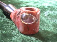 Lake superior paint agate churchwarden tobacco pipe with silver bezel set amethyst gemstone.