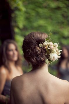 {Style Me Pretty} low bun with fresh flowers *Photography by isabelleselbyphotography.com, Floral Design by saipua.com