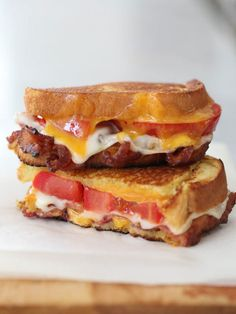 Bacon, lacy swiss cheese, and tomato is what's going on inside the BLT grilled cheese. Hello breakfast! Get the recipe at foodiecrush.com
