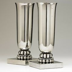 EDGAR BRANDT and GEORGE BASTARD; Pair of nickel-plated vases designed for the French ocean liner S.S. Normandie, ca. 1935