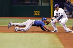 CrowdCam Hot Shot: Texas Rangers shortstop Elvis Andrus slides back into first base as Tampa Bay Rays first baseman James Loney attempted to tag him out during the first inning at Tropicana Field. Photo by Kim Klement
