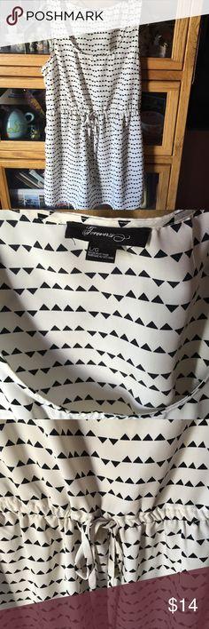 Black/white dress Adorable black/white sleeveless dress with waist draw string. EUC. Forever 21 Dresses Mini