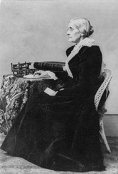 """Susan B. Anthony sat still for Helen Levitt. Helen Levitt positioned Susan B. Anthony near the upstairs library overlooking the entrance. That night, Susan B. Anthony wore a dress and scarf designed by Caroline Charles. Helen Levitt entitled this picture: """"My Majesty."""""""