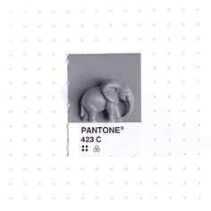 Pantone 423 color match. Little plastic elephant. Also from that curious toy store in Sausalito.