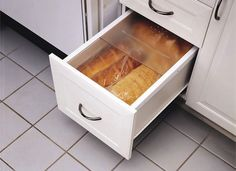 Life works better when it's organized. Customize your kitchen with specialty cabinet organizers to suit your specific needs and work habits. Smart storage solutions—everything from recycling centers to bread boxes—can be tucked away behind closed doors or concealed inside drawers, ready to slide out when needed.