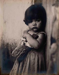 Alberto Korda, Girl with a Wooden Doll, Cuba, 1959.