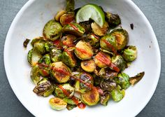 Sriracha brussels sprouts - just 3 little letters - OMG. Sriracha is a staple in our kitchen so adding it to anything is fabulous. Mix Sriracha, a little honey and lime juice and drizzle over roasted Brussels sprouts. Side Dish Recipes, Veggie Recipes, Vegetarian Recipes, Cooking Recipes, Healthy Recipes, Side Dishes, Cooking Ideas, Delicious Recipes, Food Ideas