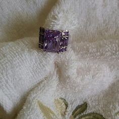 Amethyst Tourmaline Wide Band Cocktail ring Amethyst color (purple) Tourmaline Gemstones in a wide silver band setting. This gorgeous cocktail ring is a size 7. The main stone is approx 10x15 mm. There are 12 smaller, rectangular,  amethyst colored tourmalines - 6 on each side. This is a beautiful piece of Costume Jewelry and will complement your ensemble!! Jewelry Rings