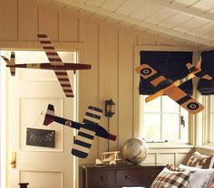 Hanging model aeroplanes for boys rooms - classic and visually impactive. These are from Pottery Barn Kids