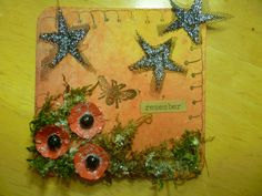 Remember - altered beer mat, poppies, bee and stars