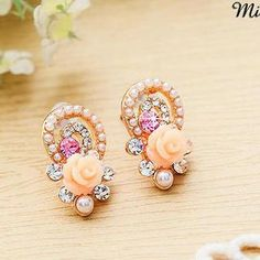 £9.60 Buy 'Miss Girl – Rhinestone Rosette Studs' with Free Shipping at YesStyle.co.uk. Browse and shop for thousands of Asian fashion items from China and more!
