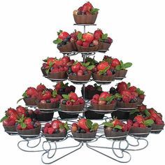 Fruit Filled Candy Cups - Candy shells, filled with fresh seasonal fruits, provide the perfect ending to your event. Guests will be impressed with the dessert  tower presentation provided by our Cupcakes 'N More Desert Stand (available in sizes to hold 13 to 38 treats).