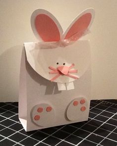 "Bunny treat: cut white cardstock 2 7/16 (just under 2 1/2) X 8 1/2. Score at 3"", 4"", 7"". Round edge with the 2 1/2 circle punch. Fold all score lines with the rounded edge as the bunny face flap to close. Bunny feet is SU! 3/4x15/16 oval punch. Ears: lg oval punch & small oval punch (retired)."