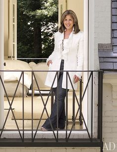Interior decorator Suzanne Kasler on a balcony at her Atlanta residence, which was renovated by architectural designers William T. Baker & Assoc.