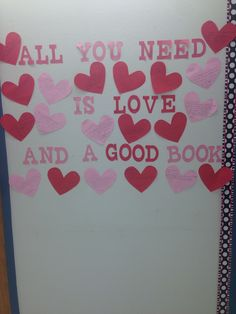 February bulletin board-students wrote book recommendations on the hearts