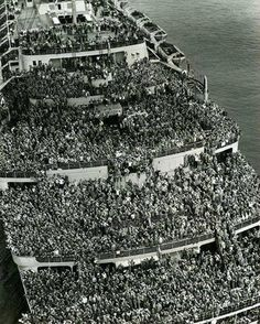 "The Liner ""Queen Elizabeth"" bringing US Troops home to NY Harbor end of WWII"