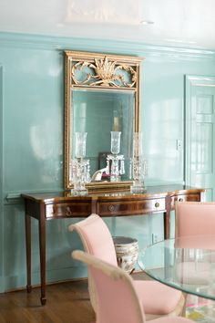 This is what lacquered walls look like! Benjamin Moore Paint Color Millspring Blue is used for this dining room. Want more ideas for your home? Click through for the full home tour