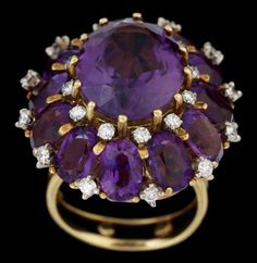 18 karat yellow gold amethyst and diamond cluster ring, Roger Lucas   mid 20th century   Oval cut amethyst prong set and framed by petite oval cut amethyst accented by petite round cut diamonds.