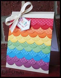 You could make this using almost any border punch and a rainbow of papers. Be sure to sponge the edges. From Erica Cerwin.