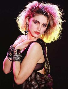 Madge definitely was up on the pastel hair trend before it was cool. Gotta love this 80's and 90's fashion icon.
