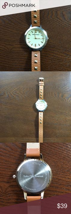 Saks Fifth Avenue Leather Watch Saks Fifth Avenue leather watch with gold tone studs in band. Saks Fifth Avenue Jewelry Bracelets
