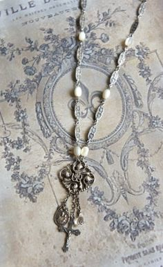 Vintage Notre Dame pendant necklace with vintage mother of pearl chain by frenchfeatherdesigns on etsy.