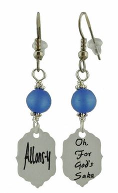 """These Dr. Who inspired earrings have the catch phrase of the 10th Dr. """"Allons-y"""" on one side and the 12th Dr. """"Oh For God's Sake"""" on the other."""