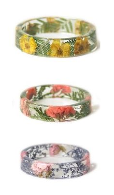 Handcrafted slip on style bangle made with real dried white flowers embedded into water clear resin.