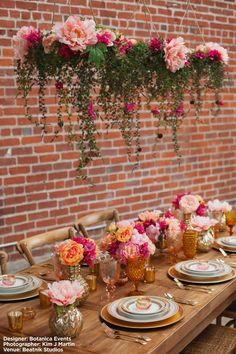 Orange, coral and pink tablescape designed by Botanica Events from product at afloral.com. #afloral Design: Botanica Events Photographer: Kim J Martin Venue: Beatnik Studios