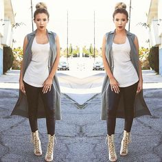 Fierce 'fit. ANGLbabe @lustrelux in our Long Tank Top. Shop all our basics in-store or online.