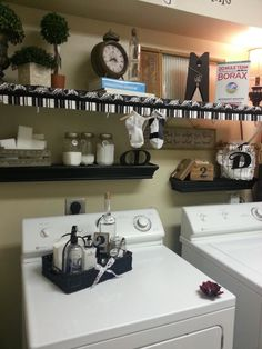 Black and white vintage style laundry room shared by a reader at 11 Magnolia Lane.  Great idea, to disguise white wire shelving with a table runner or grosgrain ribbon!