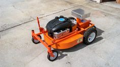 Remote-controlled robot takes mower snow-plow attachments