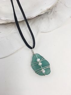 Gorgeous one of a kind genuine sea glass that is a dark turquoise. This pendant is wire wrapped with sterling silver wire and it features fresh water pearls. This pendant would be perfect as a layering necklace or for the beach and ocean lover. Shell Jewelry, Sea Glass Jewelry, Beach Jewelry, Pendant Jewelry, Jewelry Necklaces, Sterling Jewelry, Handmade Sterling Silver, Sterling Silver Necklaces, Leather Necklace