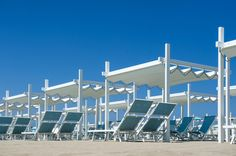 Gibus Group, leader in the production of awnings and pergolas for sun protection and energy saving Case Histories, Roofing Systems, Pavilion, Beach Club, Save Energy, Romania, Wind Turbine, Outdoor Living, Italy