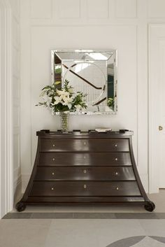 Wow love this! Where would one find such a unique piece of furniture? That chest and mirror are lovely.