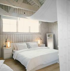 The bed and bedside table from Ikea. A home-mirror leaning against the wall. The lights come from-Granit. A sheer fabric acts as a canopy and screens of the sleeping area from the rest of the room.