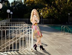 Amanda Seyfried. Accent the boots with cool/loose dress (w/ belt)