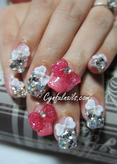 Lovely pink ribbon blinged up nails by Cynful Nails