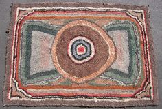 American Hooked Rug, hand woven wool on burlap, early 20thC with 19thC fabrics, great primitive design and in very good condition, size 5ft 3in x 3ft 9in, #12483