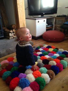 Noah enjoying the pom pom rug :)