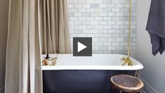 Budget Bathroom Reno | House & Home - linen shower curtain sewn by Tonic Living with gold tone grommets.